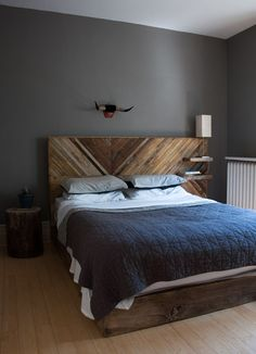 Beautiful headboard from reclaimed lathe. Made by Sean Wafter. Love the attached shelf too