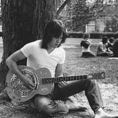 Young man plays guitar on College Green - Ohio University Archives