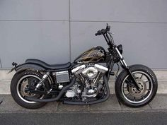 Evo Dyna swingarm custom with low profile two person seat and mag wheels