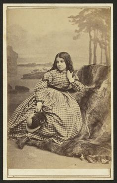 """Rebecca, the slave girl - 1863 or 1864. (Title written in pencil on back of the mount.)  Rebecca Huger, an 11-year-old who by all appearances seems white, were a reminder to people that the slave laws might at some point enslave """"whites"""" as well."""
