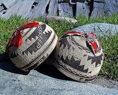 Women's Basket Caps. These caps are symbolic of the Hupa culture, with the complex geometric designs woven into various materials. Worn by women during religious festivals and on formal occasions, they are made of hazel sticks, black fern, bear grass, willow roots, porcupine quills and maiden hair ferns. LBD
