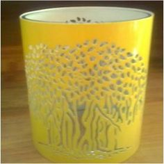 This would look neat with an image of the sun on it! Yellow Candle Holder