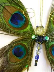 use peacock feathers and beads to make butterfly (inspiration only no instructions)