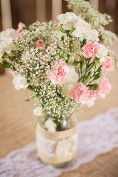 Pink Carnation and Baby's Breath Centerpieces. Love it!! Would add some light blue ones too! Carnations are so inexpensive and beautiful!