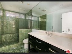 Sea green tile is so beautiful in a bathroom. Lago Vista Dr, Beverly Hills, CA