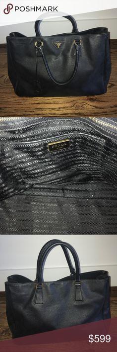 Authentic Prada Saffiano Lux Black Nero Handbag Authentic Prada Saffiano Lux Black Nero Handbag w/ original authenticity card. Has minimal wear, tear, and scuffs. Prada Bags Shoulder Bags