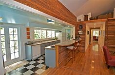 Warm wood planked and retro turquoise walls keep this shared space fresh and beach-casual. I LOVE the ample lighting in this galley kitchen!  http://www.homes.com/listing/153153140/KEY_WEST_FL_33040
