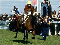 Red Rum passes the Aintree winning post in 1977 for his third win in the race