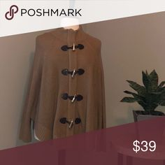 Michael Kors Poncho Sweater Camel Very Warm! The toggles are more for decoration. The sweater zips closed, so you can wear it as a mock turtleneck as shown or with the neck more open. MICHAEL Michael Kors Sweaters Shrugs & Ponchos