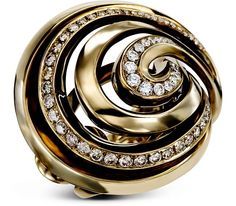 ETERNAL BLISS RING $7,700  Swirls of 18k black gold accented with brown and white diamonds.