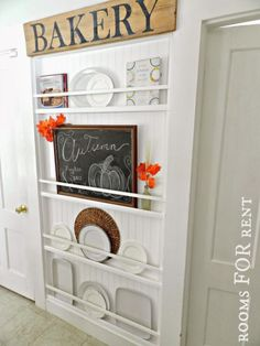 Flat Plate Rack--If a cabinet or baker's rack juts into your kitchen's traffic pattern, try this country-chic idea. Smartly hung rails show off dishes and platters while storing them securely. Get the tutorial at Rooms for Rent Plate Rack Wall, Diy Plate Rack, Plates On Wall, Kitchen Wall Storage, Kitchen Decor, Diy Kitchen, Kitchen Ideas, Kitchen Display, Deco Champetre
