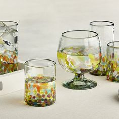 Bits of molten glass speckle rainbow confetti on clear recycled glass in fiesta-seeking glassware. Chunky shapes serve up generous pours of sangria, margaritas, beer and more, adding zesty Latin flair to your next gathering. Due to their handcrafted nature, glasses will vary slightly in size and capacity.<br /><br /><NEWTAG/><ul><li>Handcrafted</li><li>Recycled glass</li><li>Hand wash</li><li>Made in Mexico</li></ul>