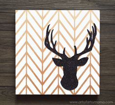 DIY Glitter Reindeer Canvas Wall Art using herringbone wall stencils from Royal Design Studio - via artsyfartsymama