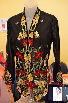 Display of the Nyonya Kebaya Embroidery by Kim Fashion and Trading, Penang, Malaysia at the Peranakan Museum.
