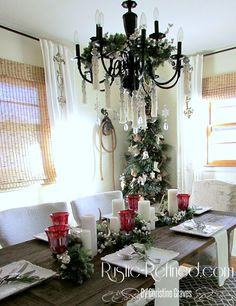 Traditional holiday tablescapes don't have to be difficult. Using what I have and one greenery swag, I had this table set in less than 6 minutes. Holiday Tablescape, Christmas Tablescapes, Christmas Traditions, Christmas Ideas, Greenery, Table Settings, Chandelier, Ceiling Lights, Wreaths