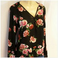 """40% BUNDLE DISCOUNT! FREE SHIPPING ON BUNDLES! FOREVER 21 Dressy Hi-Lo Roses on Sheer Black, 3 button with loop closure on v-neck, gathered at front shoulder seams, button cuff long sleeve hem, gathered at top back neckline, sheer 100% polyester, SEE MEASUREMENTS: 24 1/2"""" length front shoulder to hem, 28 1/4"""" back length shoulder to hem, 20"""" bust laying flat, 15"""" sleeves, 21"""" waist laying flat. Tag says small READ MEASUREMENTS. 40% BUNDLE DISCOUNT! FREE SHIPPING ON BUNDLES!! """"OFFER"""" $6 LESS…"""