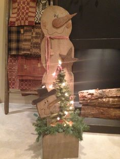 Wooden Snowman with lighted Christmas tree makes a great focal point for your porch or living room.