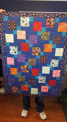 Disappearing 9 patch with fish border.  Used up some leftover charm squares.
