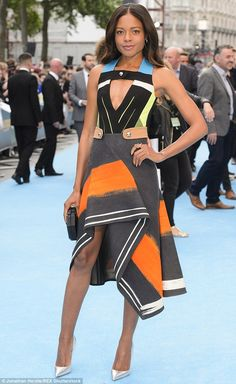 Pop of colour: Naomi Harris wore the most vibrant ensemble of the night as she rocked a mu...