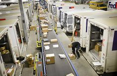 FedEx drivers grab packages off a conveyor belt as they load their delivery trucks at a FedEx shipping facility in Roseville early Monday mo. Parcel Delivery, Best Part Time Jobs, Conveyor Belt, Future Jobs, Trucks, Vehicles, Rain, Band
