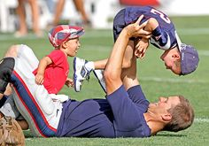 Take your kids to work day! New England Patriots Quarterback Brady bonded with his sons John and Benjamin during a break from training camp in Foxboro, Mass. (Brady and wife Gisele Bundchen also share daughter Violet, born in December 2012.)
