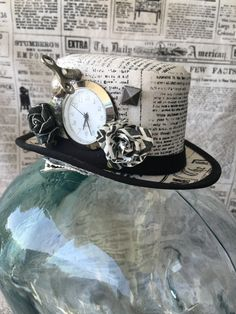 Available on etsy.com/shop/arcaniumdesign : Steampunk Mini Top Hat Fascinator -Newsprint with Clock and Embellishments