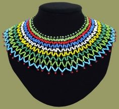 Traditional African Beaded Necklaces handmade by highly skilled Zulu Beadworkers from South Africa. African Jewelry including beaded bangles, bracelets and earrings. African Beads Necklace, African Jewelry, Zulu Wedding, Maxi Collar, Shoulder Necklace, African Crafts, African Accessories, African Men Fashion, Beaded Jewelry