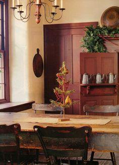 Primitive country decor; cream walls, burgundy trim, doors; distressed farm table, nice chandelier