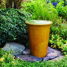 The fountain was built for about $160 (not including stones), using two glazed pots (a shallow bowl nests snugly inside the larger pot), a bucket, and a small recirculating pump.