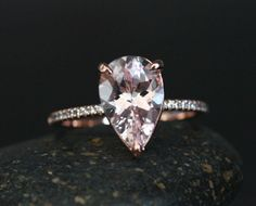 Laura Pink Morganite Engagement Ring with Pear 12x8mm and Diamond Half Eternity Band by Twoperidotbirds on Etsy https://www.etsy.com/listing/230916565/laura-pink-morganite-engagement-ring