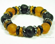 Black and Amber Bracelet featuring Recycled Glass, Fair Trade Beads.  Available for purchase on our online store.  www.bigvillage.ca $16