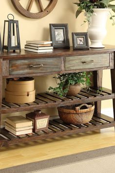 The rustic, weathered look of this distressed console table will bring a vintage look to any room. Click to get the look on Wayfair.