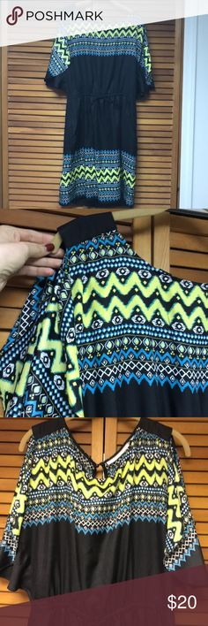 Aztec Print Dress 100% polyester, silky outside feel with another lining/slip inside, adjustable front tie, 2 front pockets, peep hole with button in back, arm sleeves- tank with extra shoulder and upper arm coverage of material. Worn 1x in perfect condition New York & Company Dresses Midi