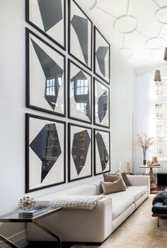 Duplex in Greenwich Village. Black and white gallery wall.