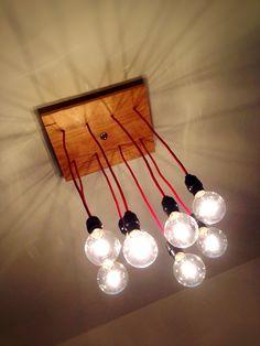 BULBO PALLET. Lámpara montada en madera de primera calidad, acabado natural, 8 luces de globo mediano y sockets negros. Dimmer y cable textil rojo importado. www.facebook.com/TreebonesPallets   Pedidos ---> treebonespallets@gmail.com