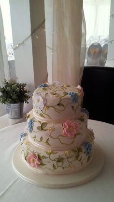"Hand painted wedding cake with sugar flower detail.  10"" vanilla, 8"" chocolate, 6"" lemon :o)"