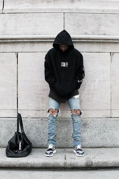 Simplicity at its best in Black Hoodie, Light Blue Ripped Jeans and a pair of Black Grey Shoes