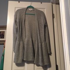 Fly Away Cardigan This is a knit fly away cardigan with a large, light ruffle bottom. It's a light, heather gray and has only been worn once. Size large. Elle Sweaters Cardigans