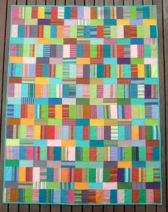 Chaos quilt.  I think the fabric looks like Kaffe Fasset's shot cottons and stripes.