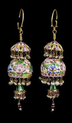 Persia | Qajar enamelled gold earrings;  hemisphere decorated with pink, green, blue and white enamel in floral designs with birds, surmounted by a smaller ribbed hemisphere similarly enamelled, seed pearls suspended from each hemisphere; with a pendant drop with seed pearls and glass beads | 19th century | Est. 3'000 - 4'000£ ~ (Oct '11)