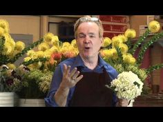 """Michael Gaffney sharing the secrets on how to preserve flowers at the Flower Design School in San Francisco.  Mr. Gaffney is also the Director of the """"Chicago School of Flower Design,"""" San Diego School of Flower Desgin, New York School of Flower Design, Minneapolis School of Flower Design, Milwaukee School of Flower Design, Miami School of Flower..."""
