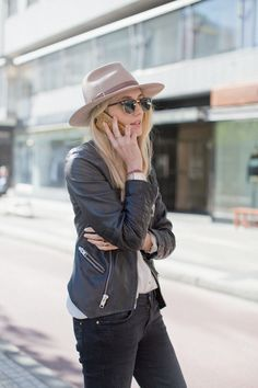 {Street style} | Tan hat, black leather jacket, off-white button up blouse, black jeans.