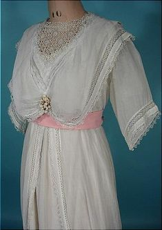 From the website: c. 1912 White Cotton Batiste Gauze Fishtail Trained Gown!