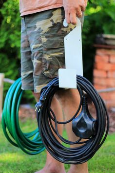 You can easily move the holder and the cords or water hose to other side of your yard.  #finelady #BecomesYou #PracticalityAndBeauty #Garden #gardening #gardenhoseholder #waterhoseholder