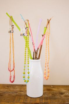 DIY Jewelry Displays // Colored Branch Jewelry Holder // learn how to on the blog & display your bits!