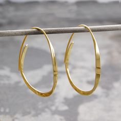 A unique take on the traditional hoop, these Curl Gold Hoop Earrings will definitely get noticed. Gradually tapered, these hoops look wonderful and are easy to wear, too! These Curl Gold Hoop Earrings are also available in sterling silver. #Otisjaxon #Jewellery