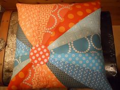 Great design and colors. Do these look like neckties? Huh, I could use the hubs old ties for some cool pillows, now that he's retired. ; D
