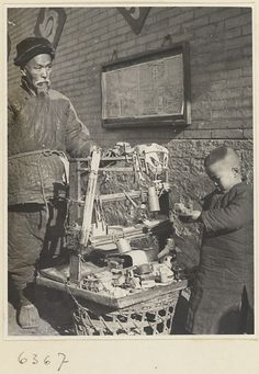 """Toy Vendor with gong called a tong luo, display stand, and boy holding a toy"" The Hedda Morrison Photographs of China, 1933 – 1946 Old Pictures, Old Photos, Vintage Photographs, Vintage Photos, Boxer Rebellion, Old Shanghai, China Image, Poster Series, Asian History"
