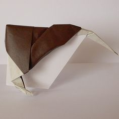 April 1st 2015 Origami kiwi bird I made yesterday. I placed it on a piece of folded paper so it stands up. Inspired by @tadashiorigami #origami #kiwi #bird #brown #diy #craft #paper #folding #91