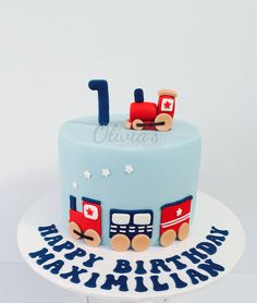 Sweet little train cake for a first birthday celebration.